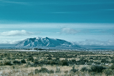 Winter on the INL. The mountain is the Big Southern Butte. Photo copyright Ralph Maughan